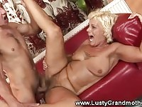 Horny blonde granny getting nailed on the couch